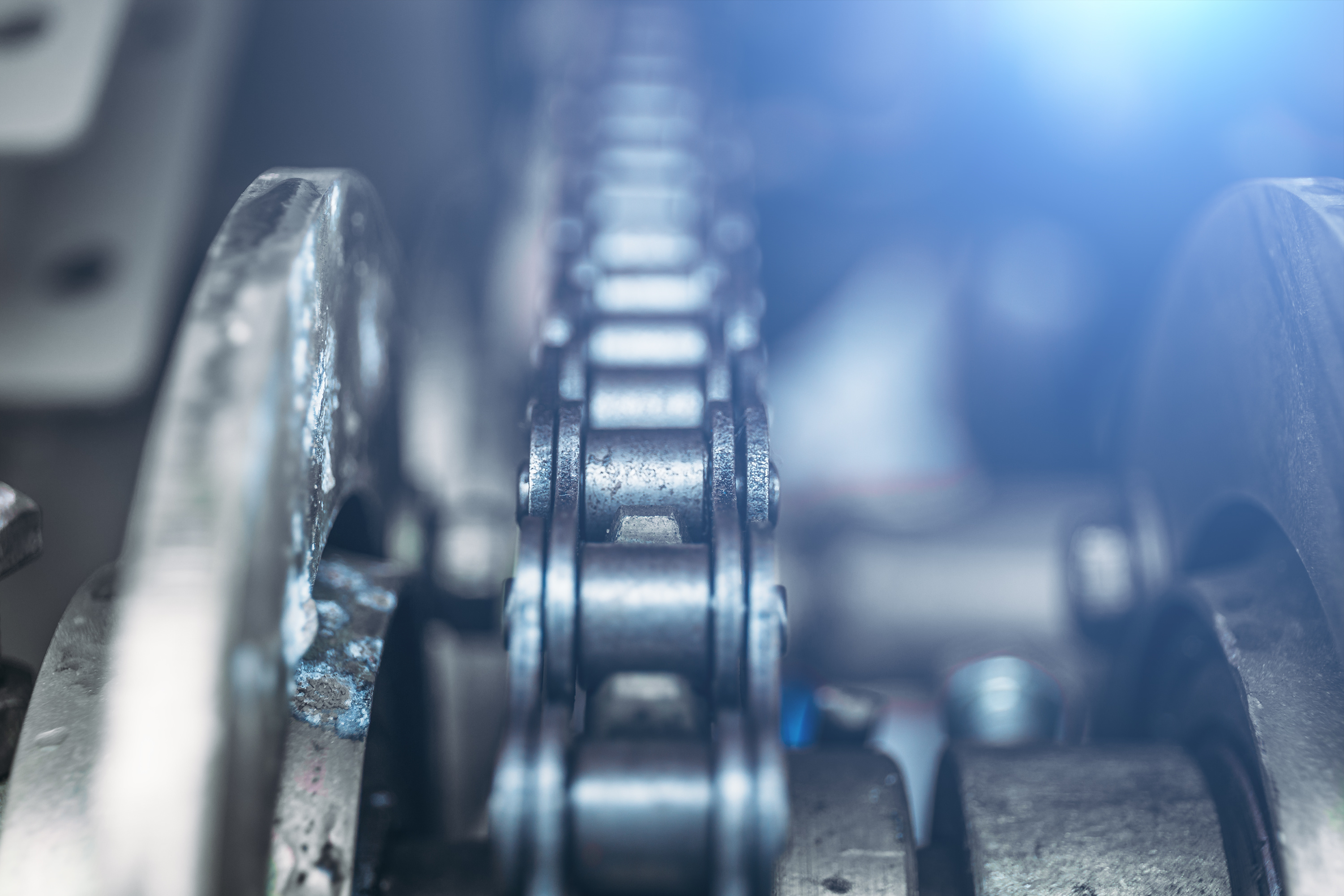 Industrial roller chain, technology background with selective focus